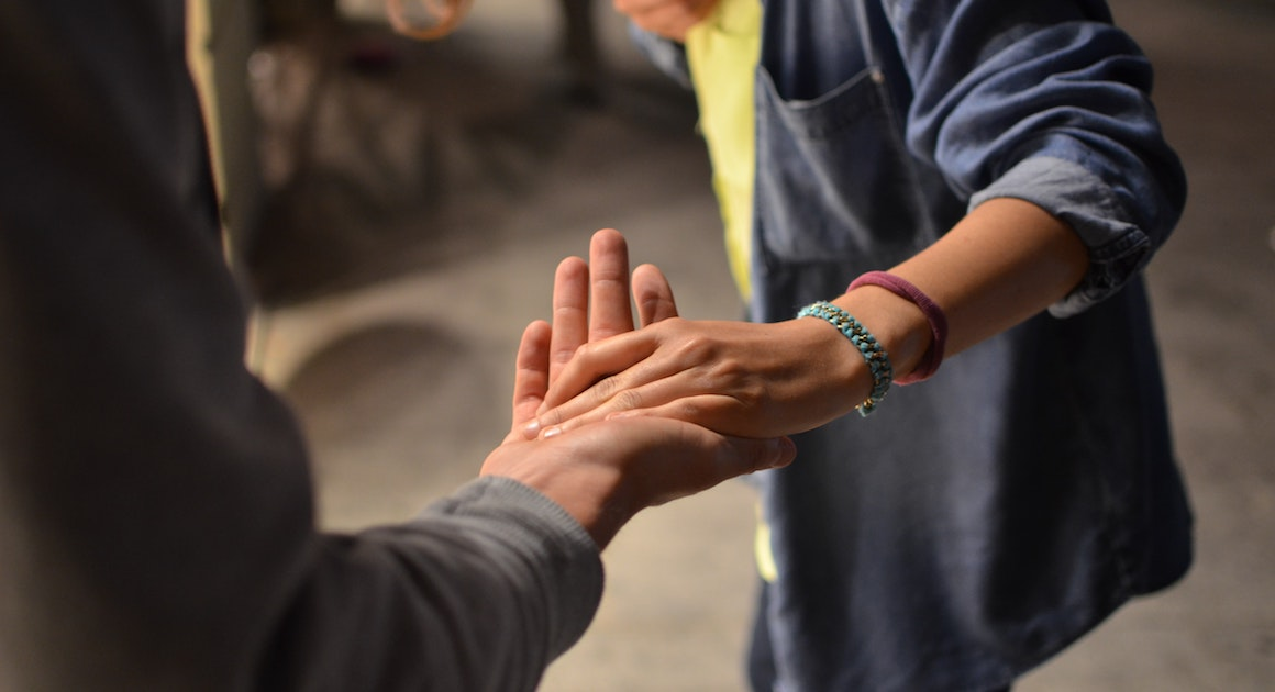 a man and woman hold hands