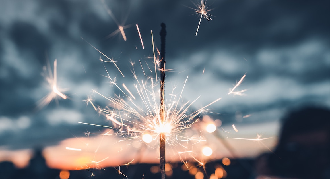 a sparkler against a sky