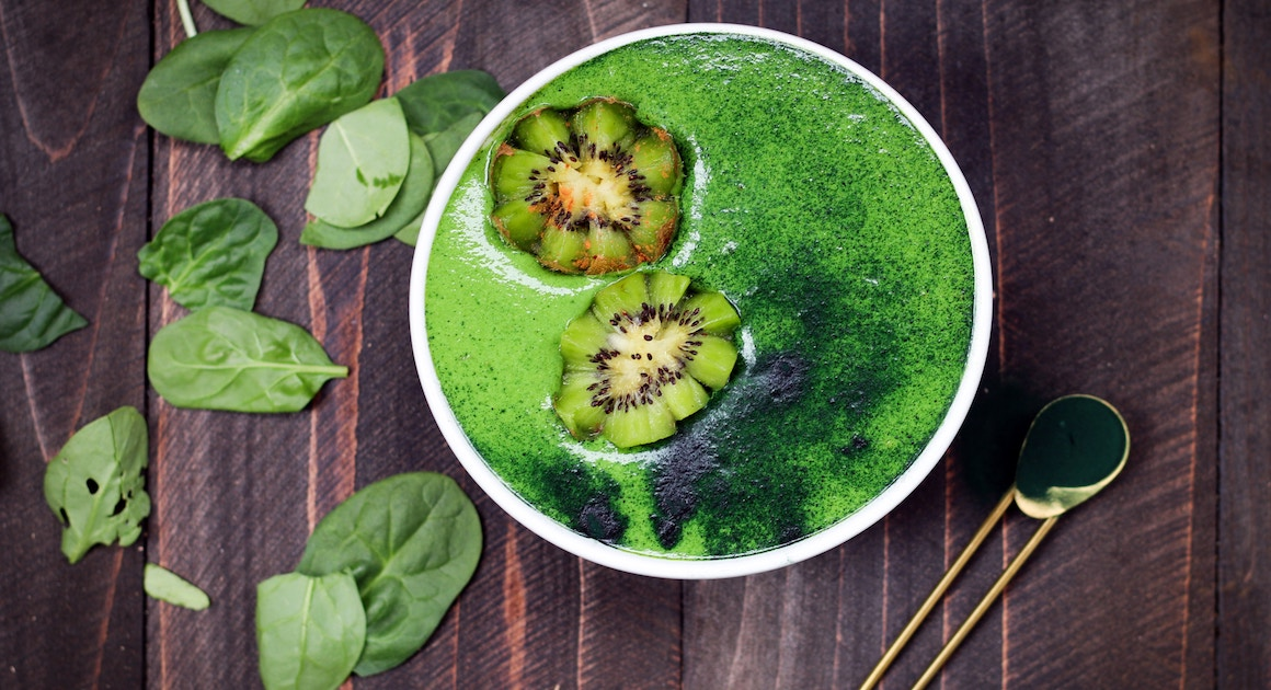 a bowl of spirulina on a table