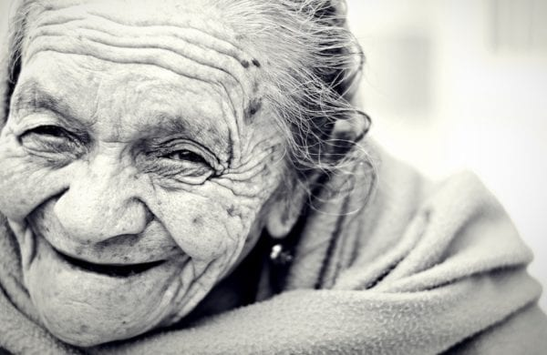 old woman smiling with wrinkles