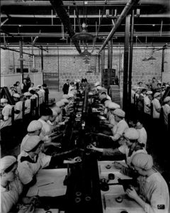 Factory workers on an assembly line