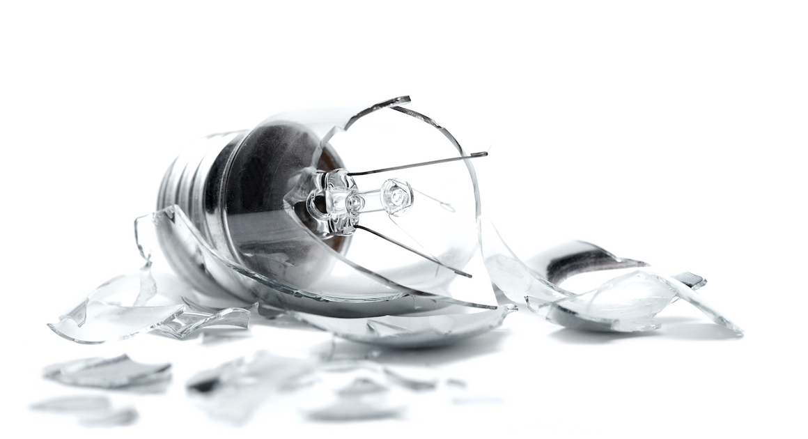 a broken light bulb on white background