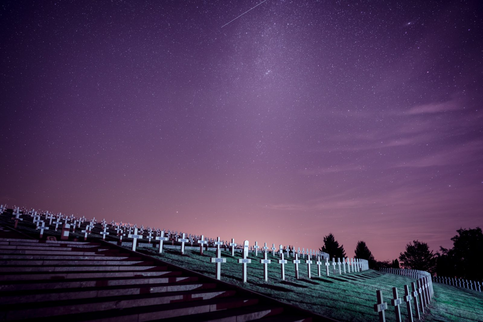 rows of graves beneath a night sky