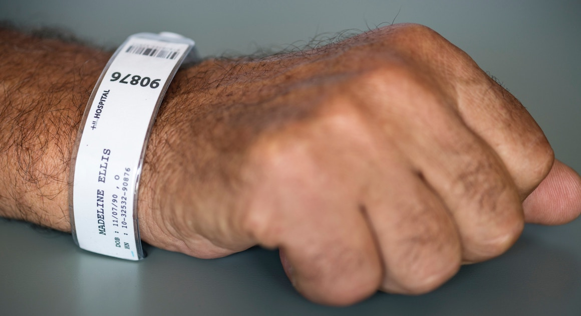 a wrist band around a hospital patient