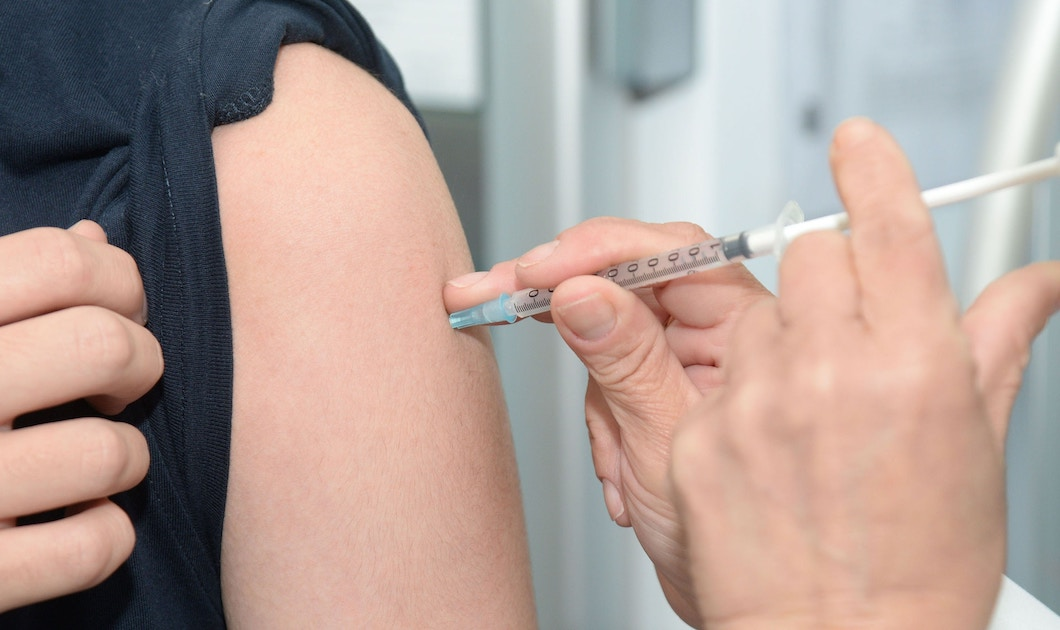 giving an immunization in an arm