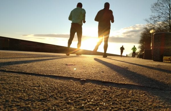 two men run with the sunrise